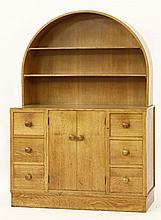 An oak 'Nursery' dresser,  by Heal and Son, after a design by Sir Ambro