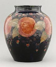 A Moorcroft 'Pomegranate' vase,  green signature, impressed marks,