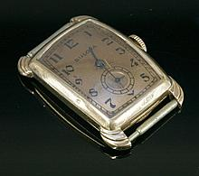 An Art Deco rose gold Bulova mechanical tank watch,  with a curved rect