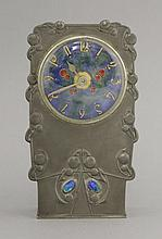 A Tudric pewter and enamel clock,  c.1903, designed by Archibald Knox f