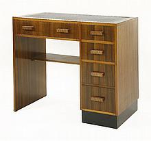 An Art Deco walnut desk,   with a tooled leather top over a single pede