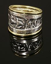 A silver and gold tapered band ring,  by Patricia Ann Fruttauro, with a