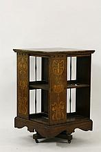 A Shapland & Petter inlaid oak revolving bookcase,  with finely turned