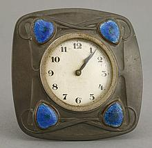 A Liberty's Tudric pewter desk clock,  each corner inset with heart-sha