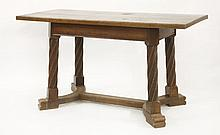 An Arts and Crafts oak centre table,  the rectangular top on twist turn