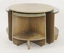 An Art deco walnut nest of tables,  the segmented and veneered circular