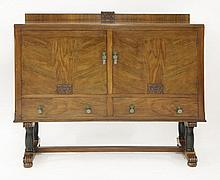 An Art Deco walnut and ebonised sideboard,  with carved detailed panels