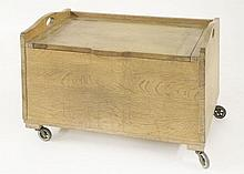 An oak shoebox,  by Heal's, with a hinged cover and carrying handles, r