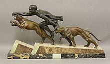 An Art Deco spelter and marble group,  modelled as a man running betwee
