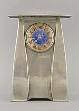 A Tudric pewter clock,  designed by Archibald Knox for Liberty & Co., t
