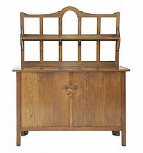 A Letchworth oak dresser,  c.1905, designed by Ambrose Heal and made by