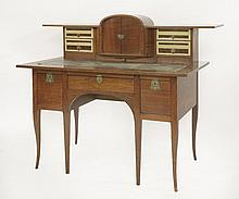 A mahogany and burr walnut free-standing desk,  c.1900, attributed to G