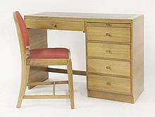 An Art Deco light walnut desk,  with a leatherette top, five drawers an