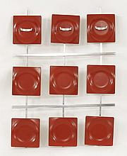 An Italian wall mounted coat rack,   c.1970, in red plastic and white m