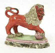 A pearlware Lion, c.1800, the red beast with grey
