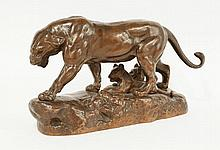 A bronze group of a lioness and her cubs with a
