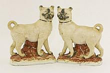 A pair of Staffordshire pottery Mastiff Dogs,