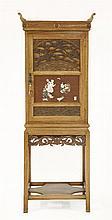 A Japanesque walnut cabinet,
