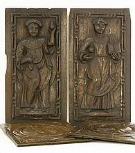 A pair of carved oak panels,