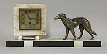 An Art Deco marble and onyx clock,  the square