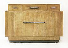 An Art Deco oak sideboard,  the raised top wit