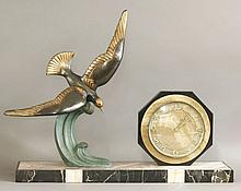 An Art Deco patinated spelter and marble clock,