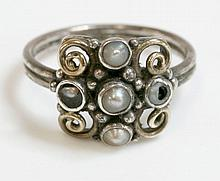 A silver and gold Arts and Crafts split pearl clus