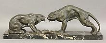 An Art Deco spelter and marble group of lions,