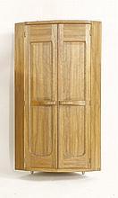 A walnut hanging corner cabinet,   by Stanley