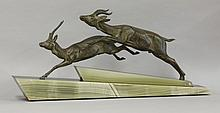 An Art Deco spelter group,  of two antelope, o