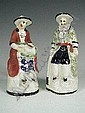 Two 19th century Yorkshire pottery figures of an oriental man and woman, (one unglazed, both with damage), 15cm high
