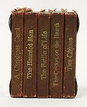 DICKENS, C: MINIATURE: The Christmas Books, A five volume miniature set, comprising: The Chimes; Christmas Carol; Cricket on the Hearth; Haunted Man; and the Battle of Live. C.1906, bound in maroon cloth and contained in the original fitted silver