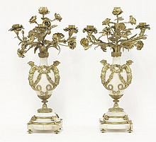 A pair of gilt bronze and white marble urn candela