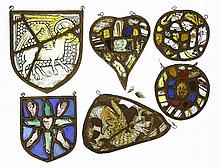 Five medieval glass panels,of shield, heart and c