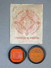 A wax seal bearing the crest of A W N Pugin,in a