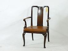 A George II solid walnut elbow chair, with a soli