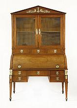 A French Empire fruitwood cylinder bureau bookcase