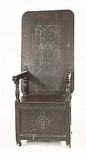 A carved oak monk's chair, 17th century and later