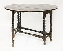 A yew wood and oak drop-leaf table, late 17th cen