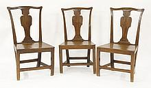 A pair of Georgian Provincial Chippendale hall cha