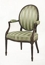 A George III mahogany elbow chair,with an oval ba