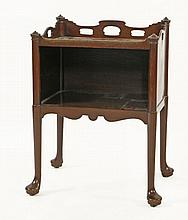 A George III mahogany open-side table,with a pier