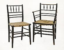 An ebonised William Morris Sussex elbow chair,