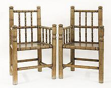An unusual pair of vernacular oak turners' chairs,