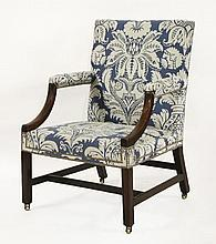 A George III mahogany library chair,on square sup