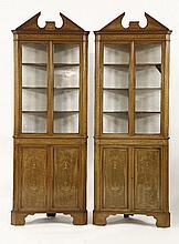 A pair of Edwardian mahogany free-standing corner