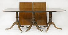 A mahogany three-pillar dining table,   George II