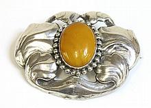A silver Danish Skonvirke amber brooch, by Bernard