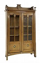 An Art Nouveau oak display cabinet, with inlaid