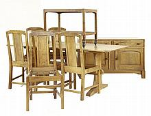 An oak dining room suite, by Stanley Webb Davies